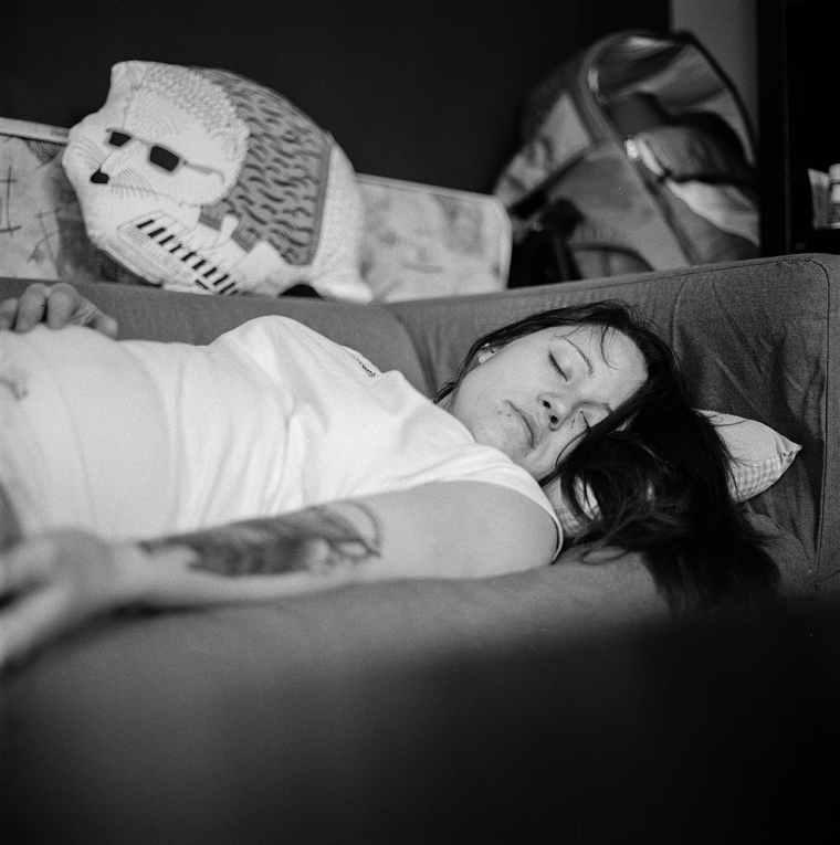 woman in white shirt sleeping on gray fabric sofa
